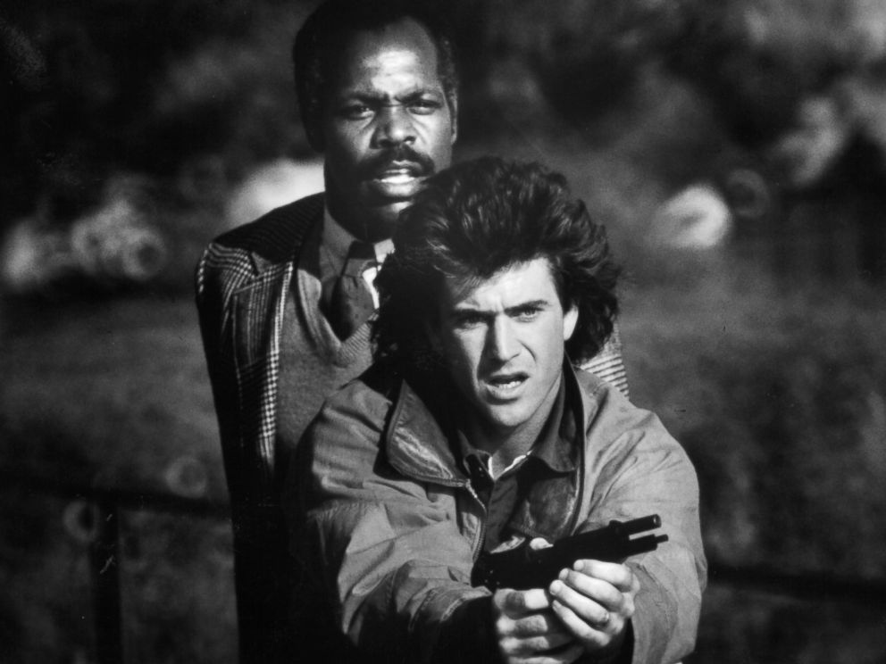 PHOTO: Danny Glover stands behind Mel Gibson in a scene from the film Lethal Weapon, 1987.