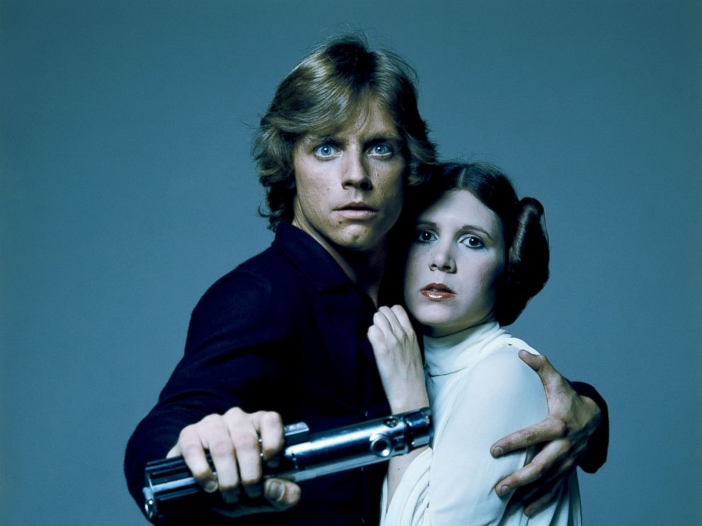 PHOTO: American actors Mark Hamill and Carrie Fisher in costume as brother and sister Luke Skywalker and Princess Leia in George Lucas Star Wars trilogy in this 1977 file photo.