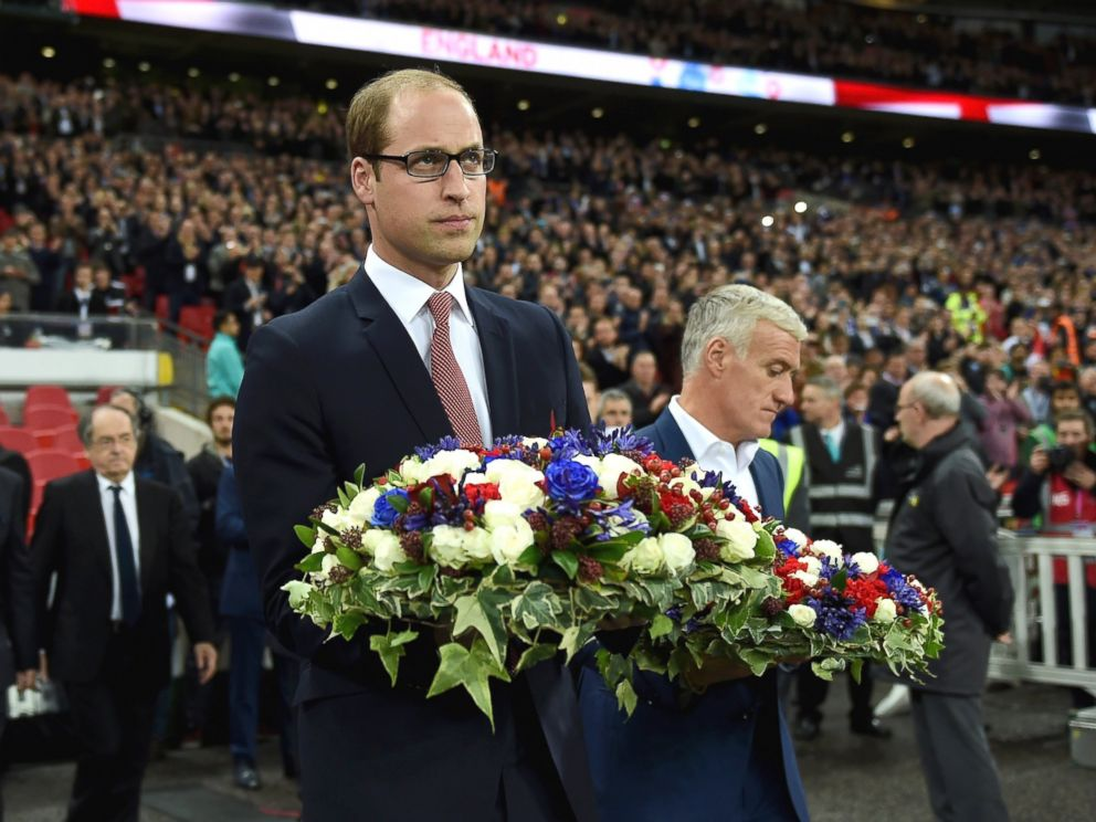PHOTO: Prince William, The Duke of Cambridge holds the floral tribute during the International Friendly match between England and France at Wembley Stadium, on Nov. 17, 2015, in London.