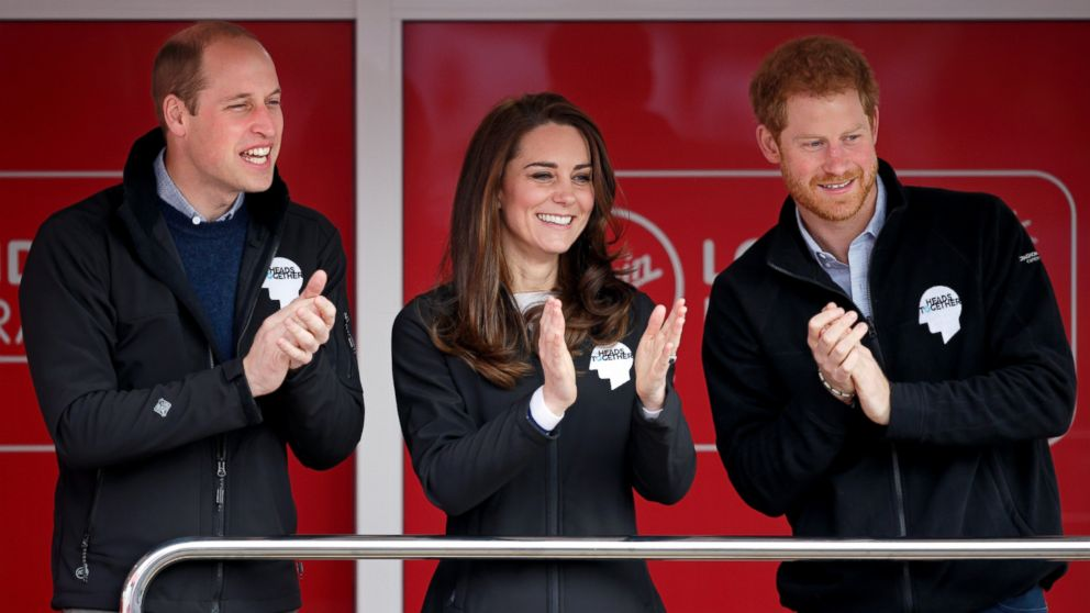 Prince William, Duke of Cambridge, Catherine, Duchess of Cambridge and Prince Harry cheer on runners as they start the 2017 Virgin Money London Marathon, on April 23, 2017, in London.