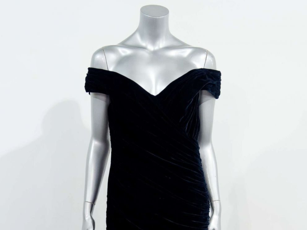 PHOTO: A picture shows a Victor Edelstein evening gown worn by Britains Princess Diana for the State Dinner at the White House in 1985, when Princess Diana danced with John Travolta, at the Kerry Taylor Auction house in south London, on March 15, 2013.