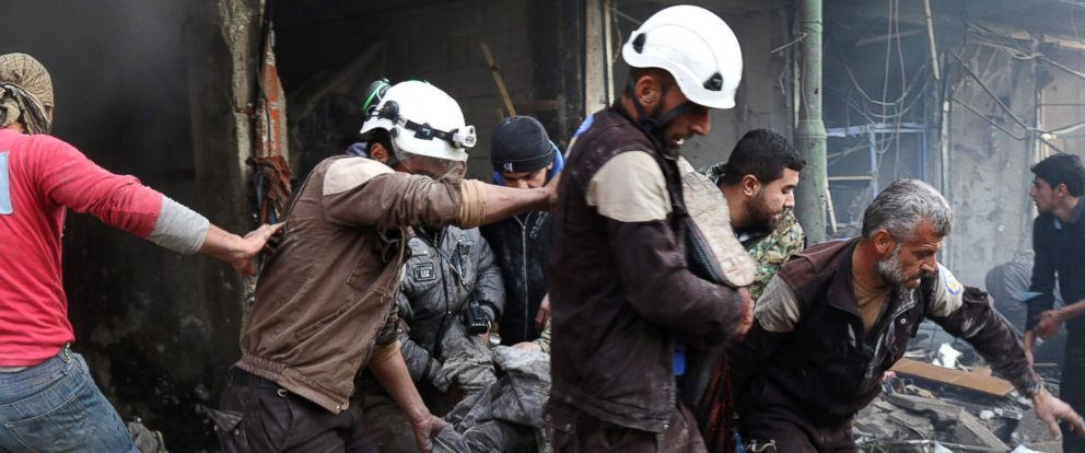 PHOTO: Syrian men and Civil Defense volunteers, also known as the White Helmets, evacuating a victim from a building following an air strike on the village of Maaret al-Numan, in the countrys northern province of Idlib, Dec. 4, 2016.