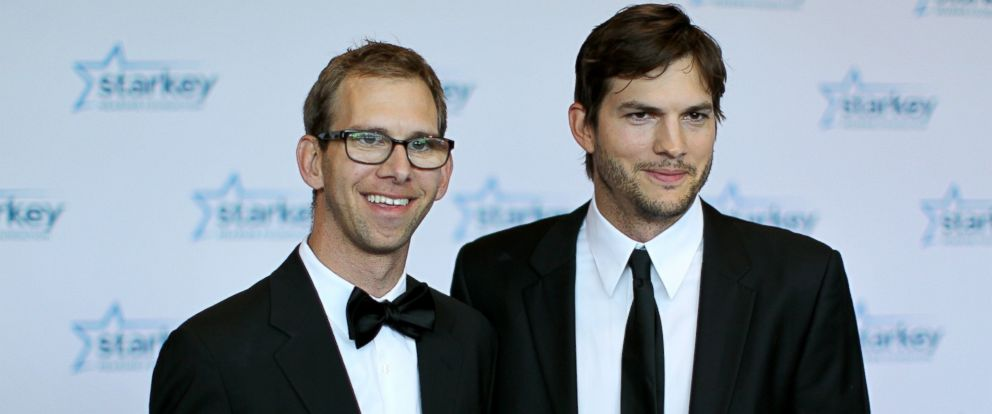 "PHOTO: Michael Kutcher and brother Ashton Kutcher walk the red carpet before the 2013 Starkey Hearing Foundations ""So the World May Hear"" Awards Gala, July 28, 2013, in St. Paul, Minnesota."