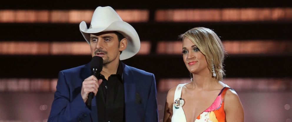 PHOTO: Brad Paisley and Carrie Underwood speak during the 49th annual CMA Awards at the Bridgestone Arena on Nov. 4, 2015 in Nashville, Tennessee.