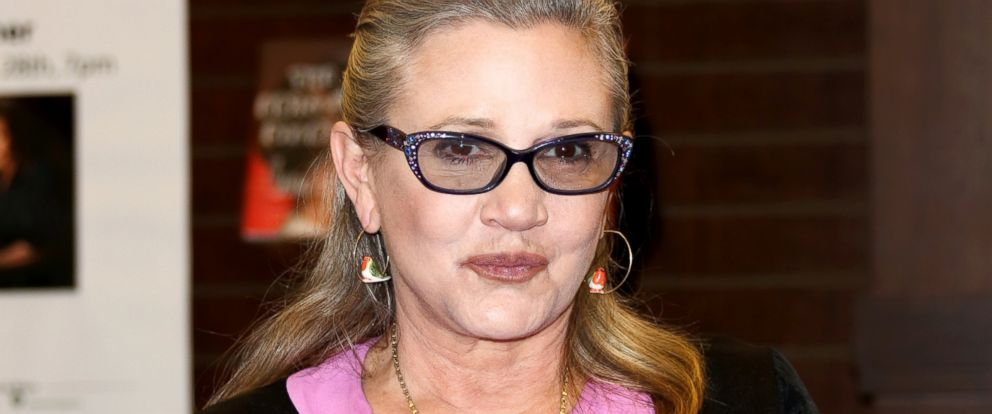 """PHOTO: Carrie Fisher signs copies of her new book """"The Princess Diarist"""" at Barnes & Noble at The Grove, Nov. 28, 2016, in Los Angeles, California."""