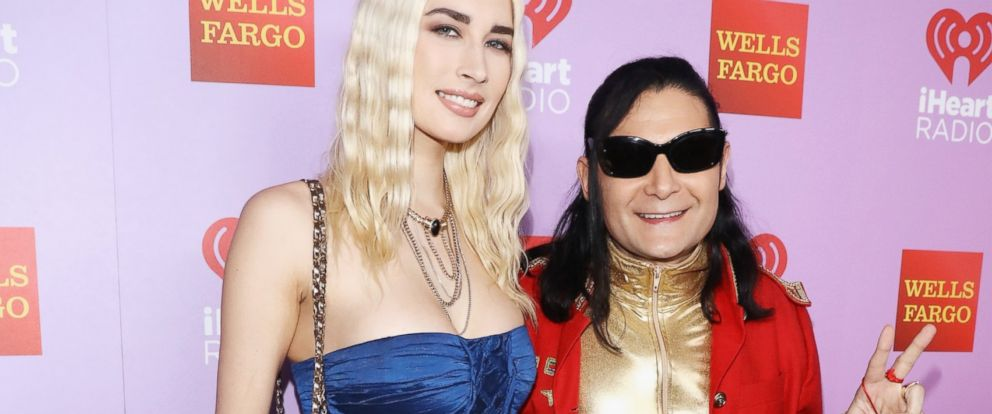PHOTO: Courtney Anne Mitchell (L) and Corey Feldman pose backstage during the first ever iHeart80s Party at The Forum, Feb. 20, 2016 in Inglewood, California.