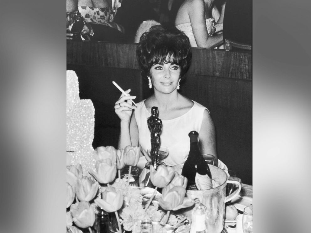 PHOTO: Elizabeth Taylor is pictured at a party in Hollywood, California, after winning an Oscar award, which is on table in front of her, circa 1961.