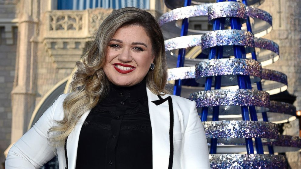 Kelly Clarkson poses for photos in the Magic Kingdom Park at Walt Disney World Resort, Nov. 10, 2016, in Lake Buena Vista, Florida.