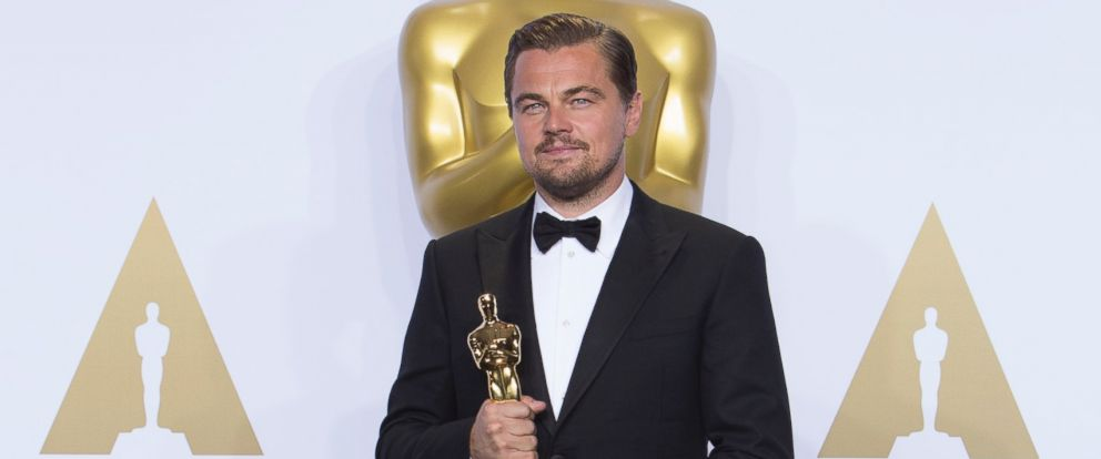 """PHOTO: Leonardo DiCaprio is pictured with his award for Best Performance by an Actor in a Leading Role in """"The Revenant"""" during the 88th Annual Academy Awards in Hollywood, California, Feb. 28, 2016."""