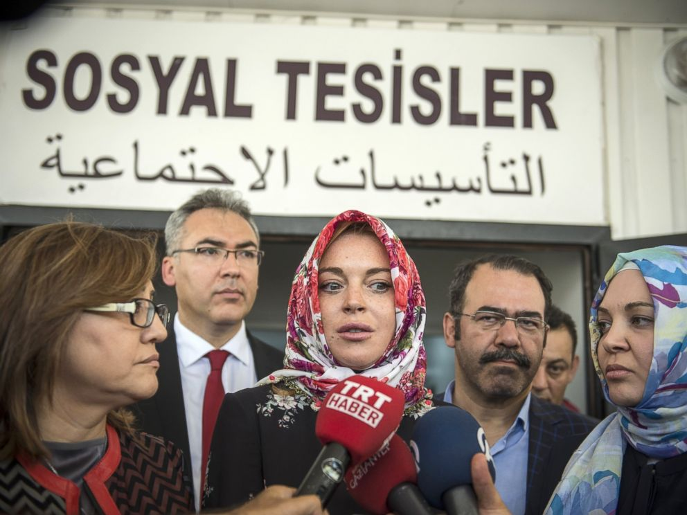 PHOTO: Lindsay Lohan speaks to press members after her visit at a container town where Syrian refugees live in the Nizip district of Gaziantep, Turkey, Oct. 08, 2016.