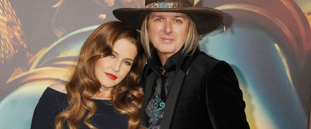 "PHOTO: Lisa Marie Presley and musician Michael Lockwood arrive at the ""Mad Max: Fury Road"" Los Angeles premiere, May 7, 2015, in Hollywood, California."