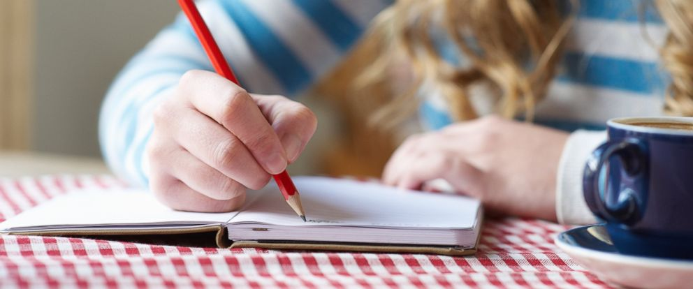 PHOTO: A woman writes on a notepad in this undated file photo.