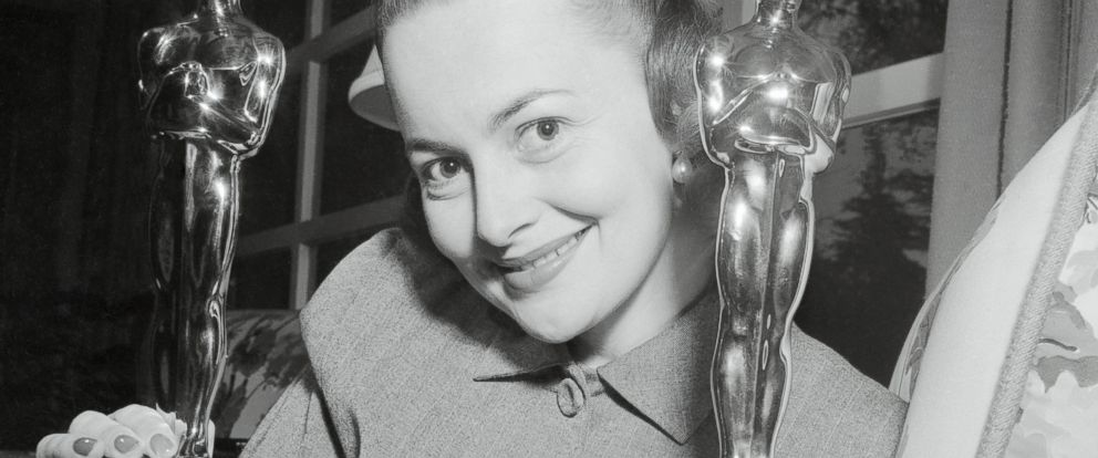 PHOTO: A 1950 portrait of Actress Olivia De Havilland and the Oscars that she has won.