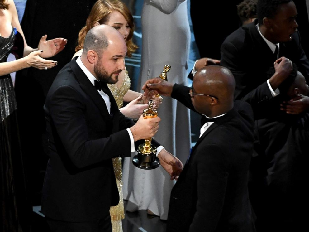 PHOTO: La La Land producer Jordan Horowitz hands over the Best Picture award to Moonlight writer/director Barry Jenkins following a presentation error onstage during the 89th Annual Academy Awards, Feb. 26, 2017, in Hollywood, California.