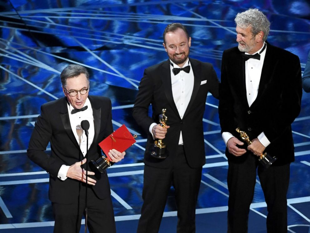 PHOTO: Sound re-recording mixer Kevin OConnell, left,and sound engineera, from left, Andy Wright and Peter Grace accept Best Sound Mixing for Hacksaw Ridge onstage during the 89th Annual Academy Awards, Feb. 26, 2017, in Hollywood, California.