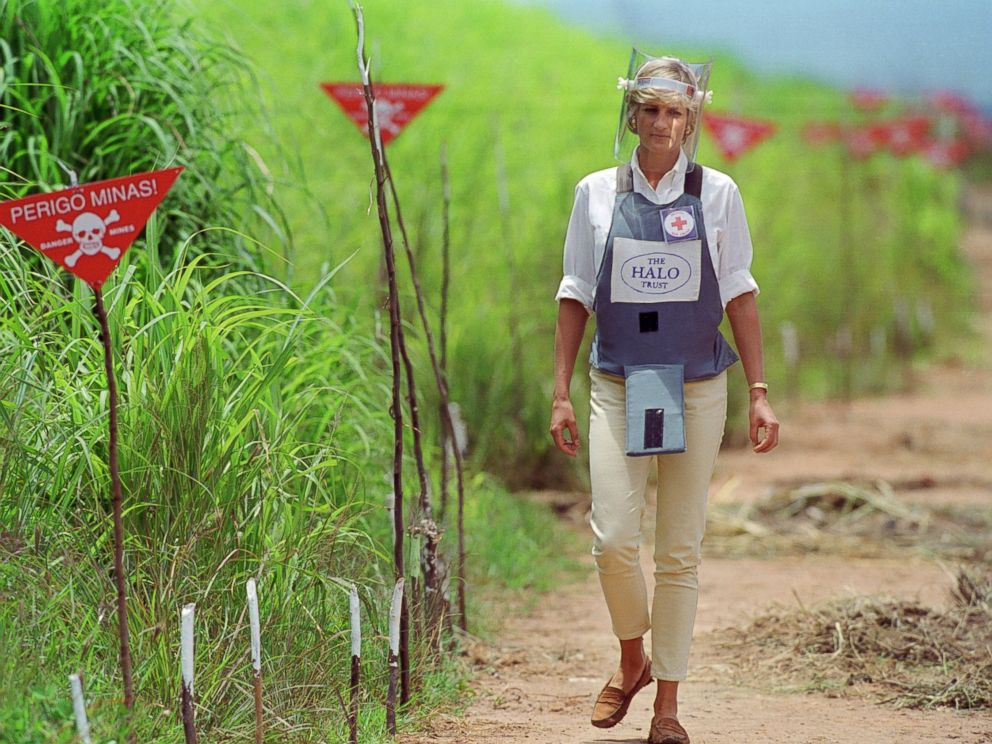 PHOTO: Diana, Princess of Wales wears protective body armor and a visor while visting a landmine minefield being cleared by the charity Halo in Huambo, Angola.