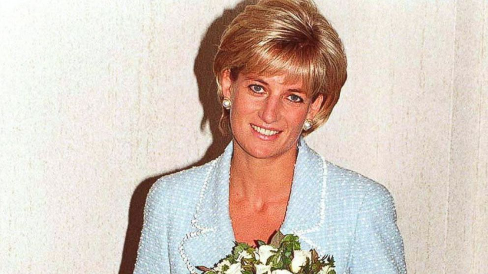 Diana, Princess of Wales is presented with the first rose to be named after her at the British Lung Foundation offices, April 21, 1997 in London, England.