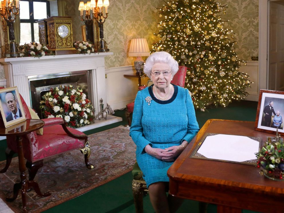 PHOTO: Queen Elizabeth II sits at a desk in the Regency Room after recording her Christmas Day broadcast to the Commonwealth at Buckingham Palace, Dec. 24, 2016 in London.