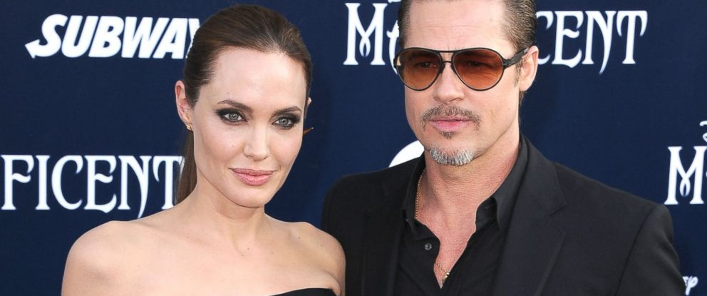 "PHOTO: Angelina Jolie and Brad Pitt at the World Premiere Of Disneys ""Maleficent"" at the El Capitan Theatre in Hollywood, California, May 28, 2014."