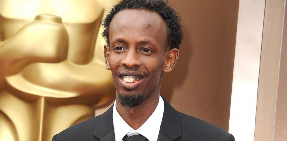 PHOTO: Barkhad Abdi arrives at the 86th Annual Academy Awards at Hollywood & Highland Center on March 2, 2014.