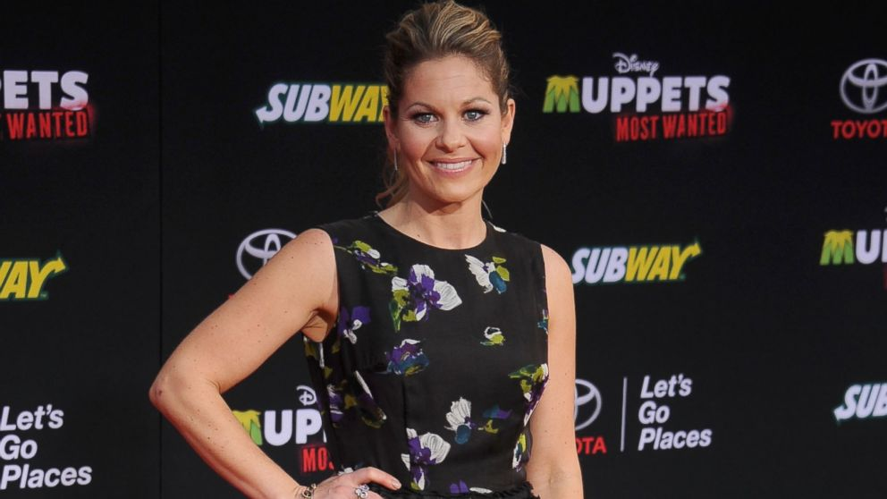 "Actress Candace Cameron Bure arrives at the Los Angeles premiere of ""Muppets Most Wanted"" at the El Capitan Theatre, March 11, 2014 in Hollywood, Calif."