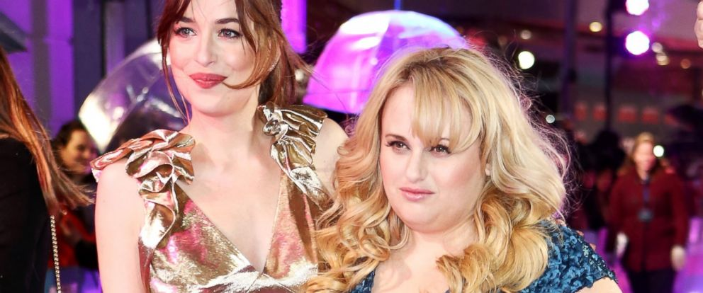 """PHOTO: Dakota Johnson and Rebel Wilson attend the UK Premiere of """"How To Be Single"""" at Vue West End, Feb. 9, 2016, in London."""