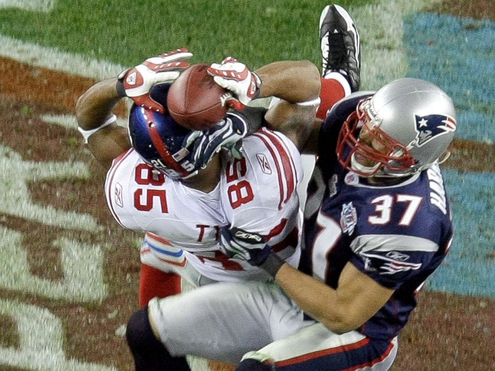 PHOTO: New York Giants receiver David Tyree (85) hauls in a long pass against the New England Patriots Rodney Harrison (37) on the game-winning drive in a 17-14 victory over the New England Patriots at Super Bowl XLII in Glendale, Arizona, Feb. 3, 2008.