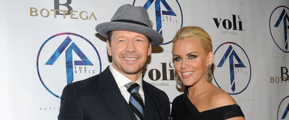 PHOTO: Actor Donnie Wahlberg and TV personality Jenny McCarthy attend the grand opening of The Attic Rooftop Lounge, June 11, 2014, in New York.