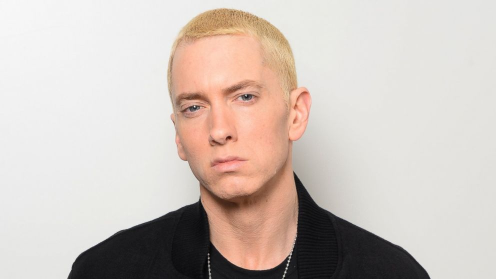 Eminem poses in his dressing room with the 'Best Hip Hop' and 'Global Icon' awards during the MTV EMA's 2013 at the Ziggo Dome on November 10, 2013 in Amsterdam, Netherlands.
