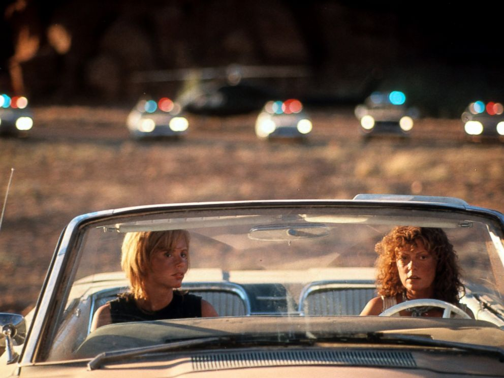 PHOTO: Geena Davis and Susan Sarandon sitting in their convertible with squad cars behind them in a scene from the film Thelma & Louise in 1991.