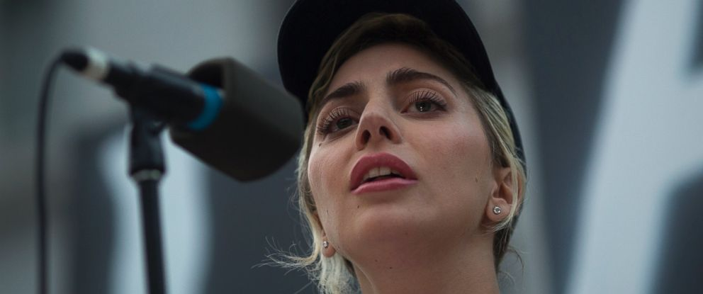 PHOTO: Singer Lady Gaga reads some of the names of the dead at a vigil for the worst mass shooing in US history on June 13, 2016 in Los Angeles, United States. A gunman killed 49 people and wounded 53 others at a gay nightclub in Orlando, Florida.