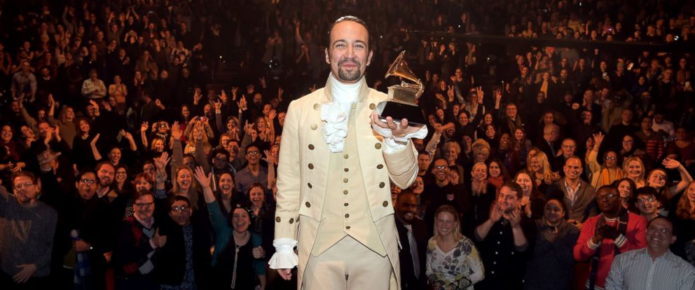 "PHOTO: Composer, actor Lin-Manuel Miranda celebrates on stage during ""Hamilton"" GRAMMY performance for The 58th GRAMMY Awards at Richard Rodgers Theater on Feb. 15, 2016 in New York City."