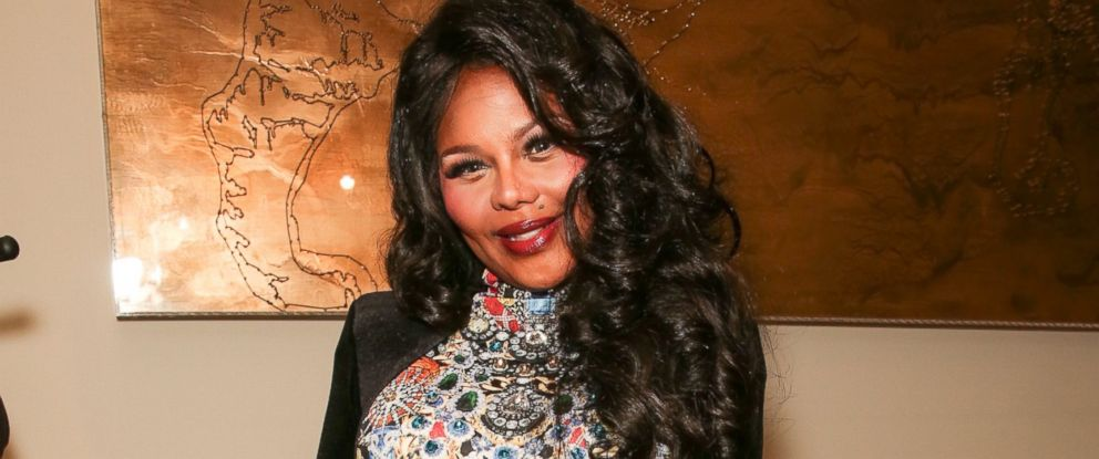 PHOTO: Rapper Lil Kim backstage at the The Blonds fashion show during MADE Fashion Week Fall 2014 at Milk Studios on February 12, 2014 in New York City.