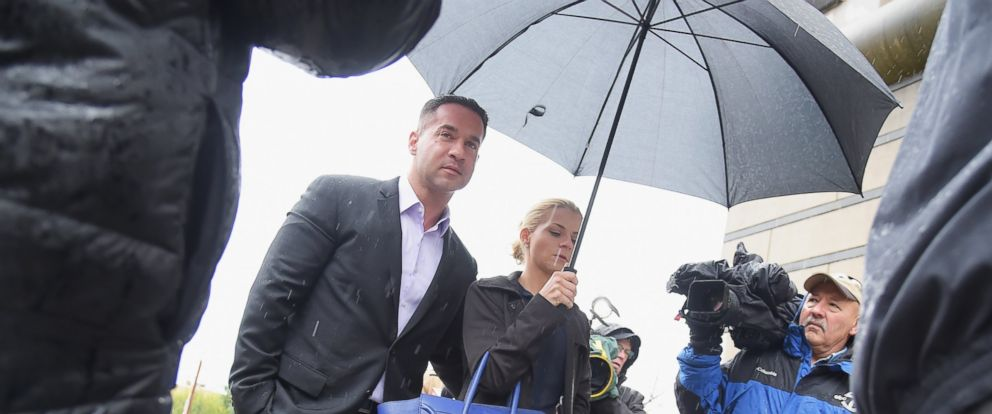 """PHOTO: Mike """"The Situation"""" Sorrentino and fiancee Lauren Pesce appear for Sorrentinos arraignment on tax fraud charges at the Martin Luther King Building and U.S. Courthouse, Oct. 23, 2014, in Newark, N.J."""