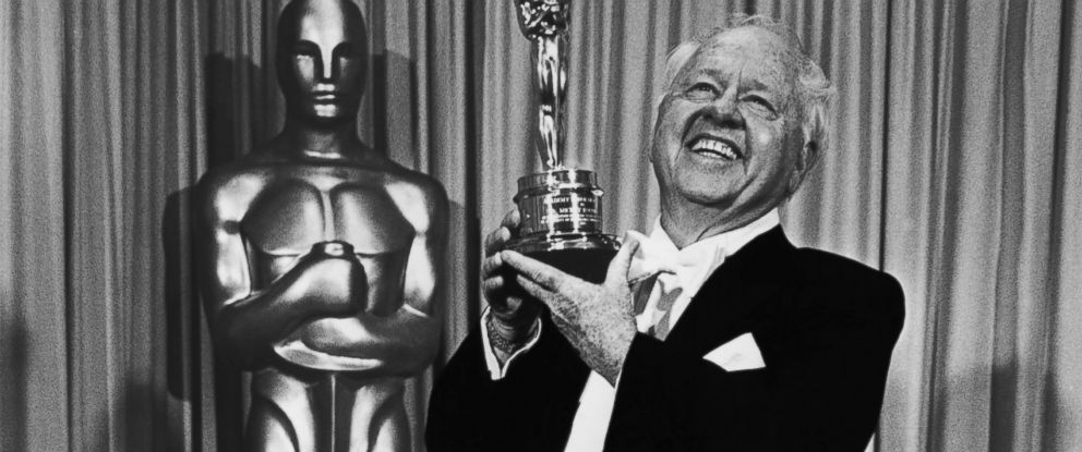 """PHOTO: Film actor Mickey Rooney poses with the """"Lifetime Achievement"""" Academy Award backstage, following his acceptance speech, at the 1982 Academy Awards in Los Angeles, California."""