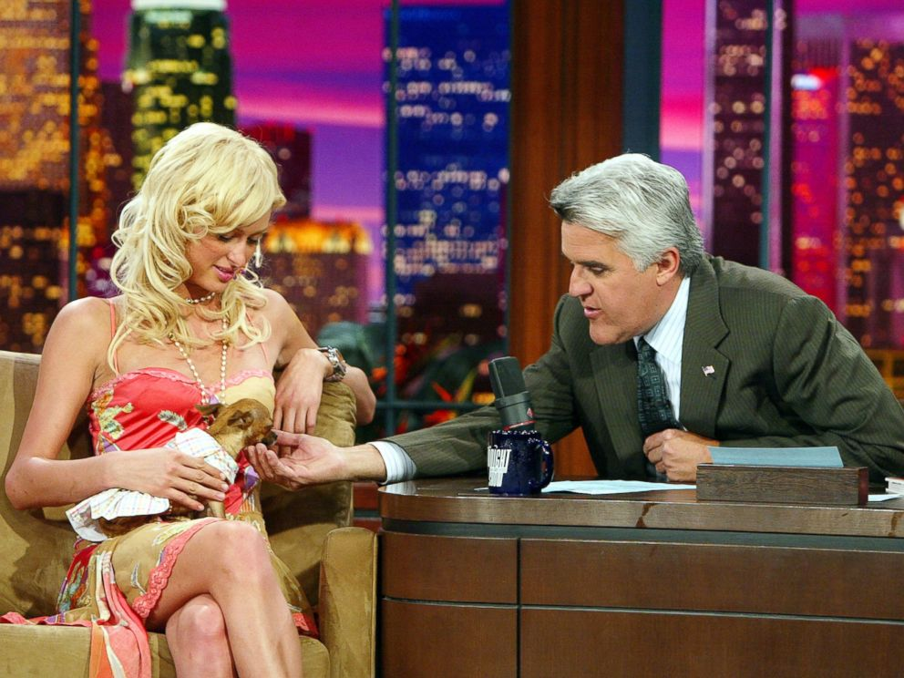 PHOTO: Paris Hilton (left), with her dog Tinkerbell, appears on The Tonight Show with Jay Leno on September 6, 2004 at the NBC Studios, in Burbank, California.