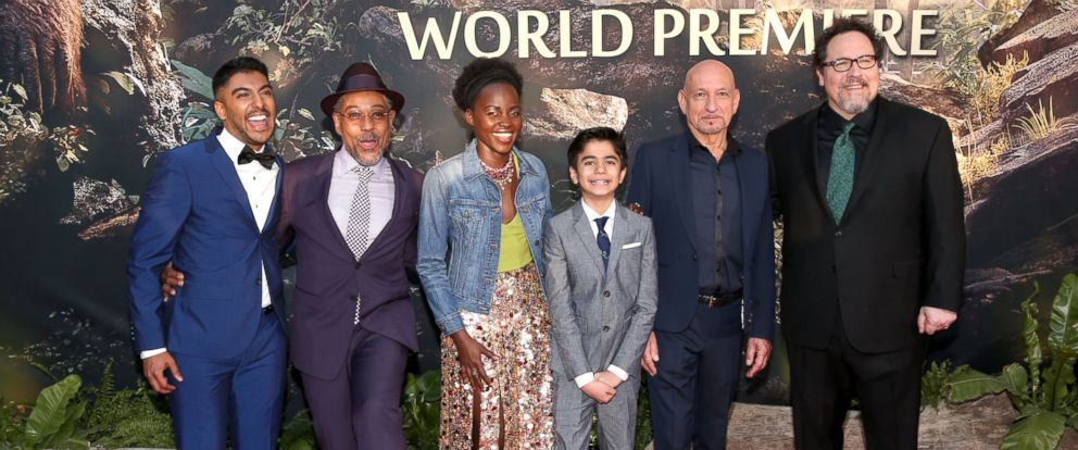"Actor Ritesh Rajan, actor Giancarlo Esposito, actress Lupita Nyongo, actor Neel Sethi, actor Ben Kingsley and director/producer Jon Favreau attend the premiere of Disneys ""The Jungle Book"" at the El Capitan Theatre, April 4, 2016, in Hollywood, Calif."