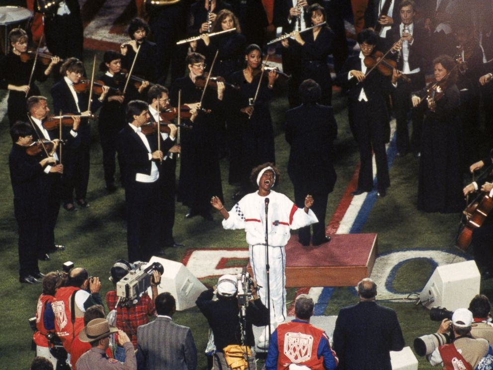 PHOTO: Whitney Houston sings the National Anthem before the New York Giants took on the Buffalo Bills in Super Bowl XXV at Tampa Stadium on Jan. 27, 1991 in Tampa, Fla.