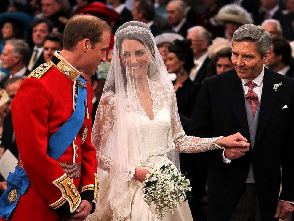 PHOTO:Prince William speaks to his bride, Catherine Middleton as she holds the hand of her father Michael Middleton at Westminster Abbey, April 29, 2011, in London.