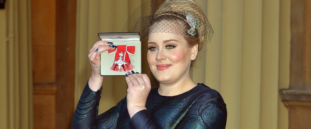 PHOTO: Adele holds her MBE award for services to music on Dec. 19, 2013 in London.