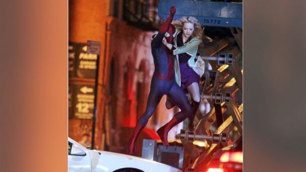 """PHOTO: Andrew Garfield and Emma Stone film an action scene on location for the film """"The Amazing Spiderman 2"""" on June 4, 2013 in New York City."""