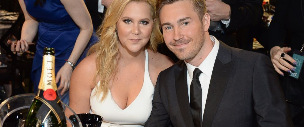 PHOTO:Honoree Amy Schumer and designer Ben Hanisch attend the 21st Annual Critics Choice Awards, Jan. 17, 2016 in Santa Monica, Calif.
