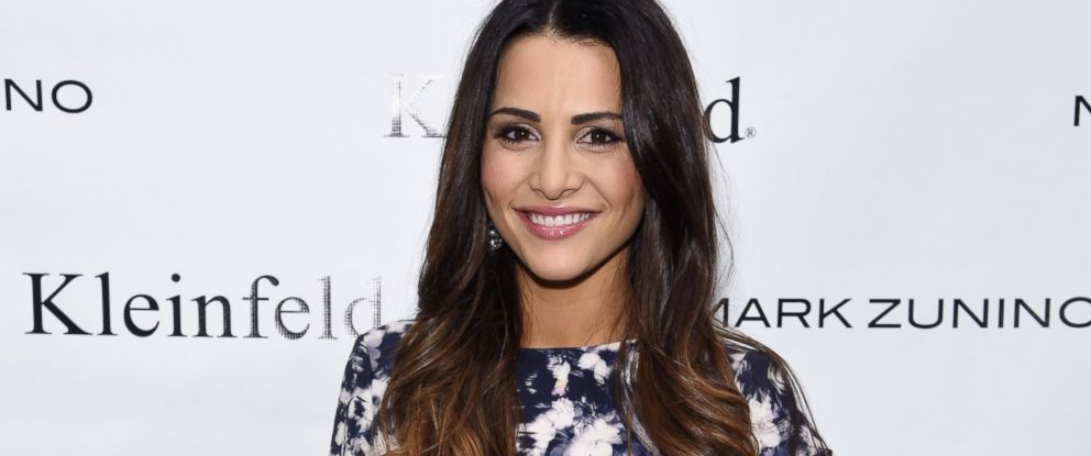 PHOTO: Andi Dorfman attends front row at The Mark Zunino For Kleinfeld 2015 Runway Show on Oct. 14, 2014 in New York City.
