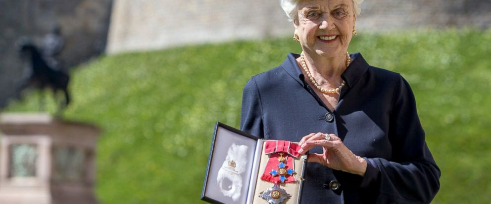 PHOTO: Angela Lansbury poses with her Dame Commander (DBE) medal given to her by Queen Elizabeth II at an Investiture ceremony at Windsor Castle, April 15, 2014 in Berkshire, England.