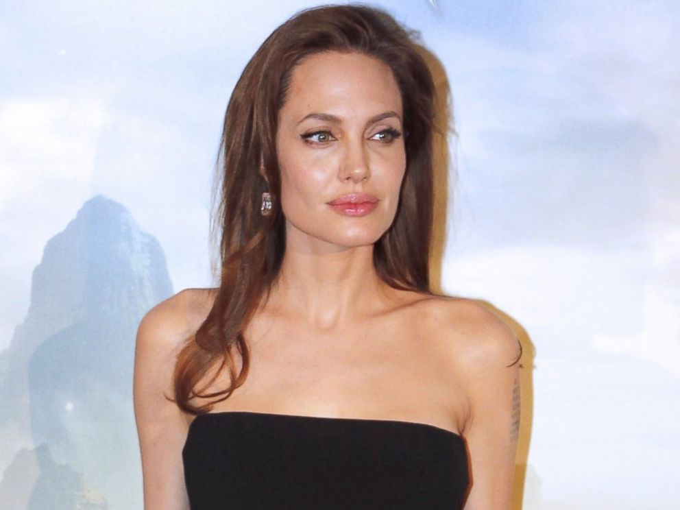 PHOTO: Angelina Jolie poses for the press presentation of the new Disney movie Malefique, May 6, 2014 in Paris, France.