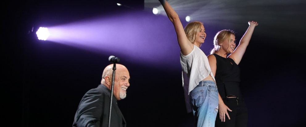 PHOTO: Actors Amy Schumer and Jennifer Lawrence join musician Billy Joel on stage for the encore of his sold out concert at Wrigley Field, Aug. 27, 2015, in Chicago.