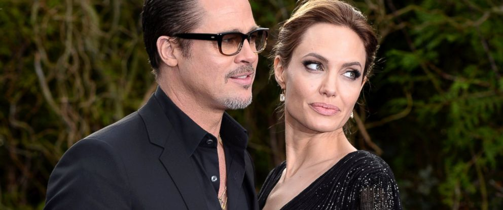 """PHOTO: Brad Pitt and Angelina Jolie attend a private reception as costumes and props from Disneys """"Maleficent"""" are exhibited in support of Great Ormond Street Hospital held at Kensington Palace, May 8, 2014 in London."""