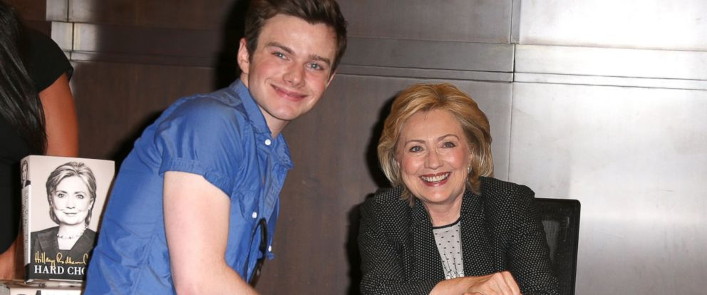 """PHOTO: Chris Colfer poses for a photo with Hillary Rodham Clinton during a book signing for """"Hard Choices"""" at Barnes & Noble at The Grove in Los Angeles, June 19, 2014."""