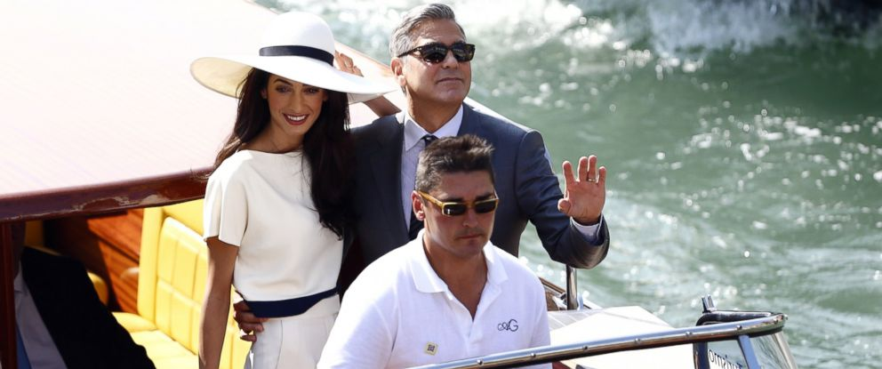 PHOTO: George Clooney and Amal Alamuddin leave the palazzo Ca Farsetti on a taxi boat, Sept. 29, 2014, in Venice, after a civil ceremony to officialise their wedding.