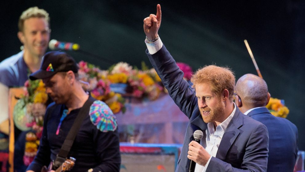 Prince Harry joins Coldplay on stage during the Sentebale Concert at Kensington Palace, June 28, 2016 in London.